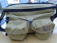 Tenba vintage camera bag, khaki colour with black carry strap.