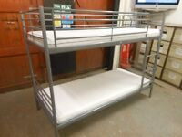 ikea svarta bunk bed frame with 2 mattresses in excellent condition. can deliver