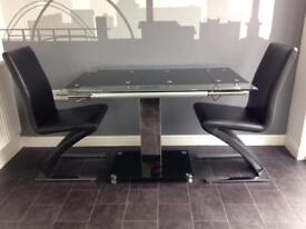 Modern glass extending dining table & chairs