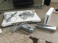 FOR SALE: WHITE WII CONSOLE, WII FIT BOARD, 13 GAMES AND ACCESSORIES