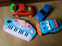 Toy cars and keyboard toy piano