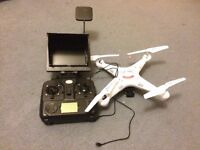 A syma x5c-1 drone with Fpv gear attached including a live preview screen