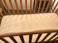 Brown cot with new mattress