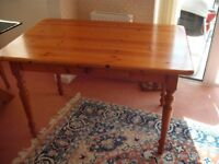 Pine kitchen table with useful drawer plus four chairs