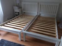 White wooden bed frames x 2