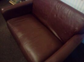 Leather 2 seater sofa, burgandy. Buyer to collect. 38 in deep 54 in wide 33 in high