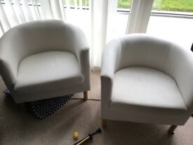 Two ikea cream tub chairs