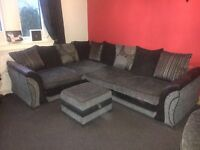 Corner sofa with built in double bed, cuddle seat & storage foot stool
