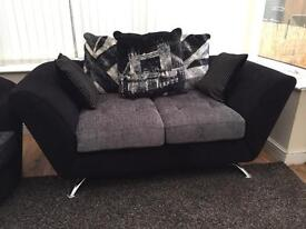 Black and grey sofa and chair