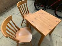 Pine table and two chairs