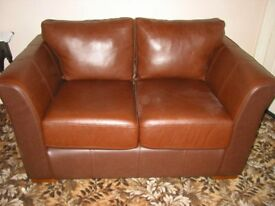 Faux leather settee.