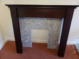Mahogany-effect fire surround / mantelpiece with grey marble-effect back panel and hearth