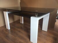 Metro Dining table with black glass top and white legs