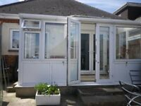 Greenhouse, previously used as small conservatory, with good mix of windows and doors.