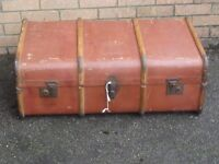 old wooden banded travel trunk suitcase