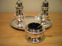 ARTHUR PRICE 3-PIECE CONDIMENT SET ON A TRAY AND A SILVER PLATED DISH. FINE CONDITION. NEVER USED.