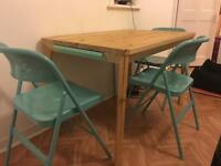 Solid pine table (120x75cm) + 3 folding chairs (great condition)