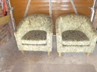2 tub chairs in a lovely jade material with a embossed flower