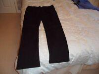 Ladies black jeans, size 16, suit taller lady.