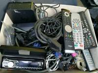 Box of assorted electrical cables and Kenwood radio front