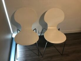 Two stylish white chairs