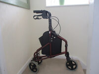 Three wheeled walker with integral zipped shopper.