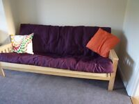 Futon Sofabed, seldom used. Plum cover, pale pine frame. Double