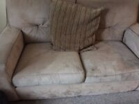 Two sofas with matching footstool
