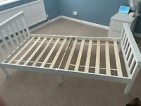 Single, white bed frame.