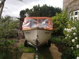 Fishing boat with collapsible cuddy ,trailer and outboard