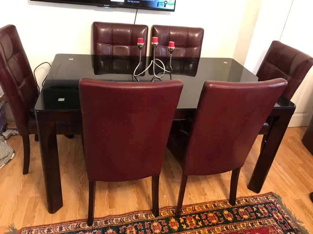 Tinted Black Gl Dining Table 6 Leather Chairs In Grays Es Gumtree