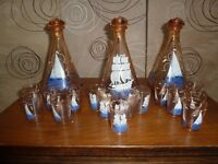 Glass wear drinking set 3 decanters 16 glasses ship pattern £8