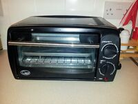 Table top oven with grill
