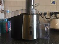 Electric Fruit Juicer with juice collecting jug