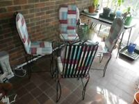 Glass Topped/Metal Framed Dining Table with 4 Matching Metal Chairs and Cushions
