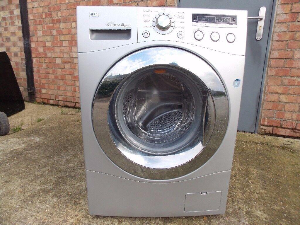 LG washing machine 8kg silver very good condition .