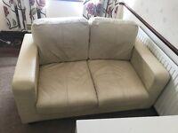 2 seater cream leather sofa.