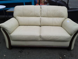Cream leather 2 seater sofa with wood trim