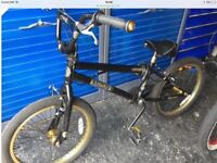BMX Bike, made by Hyper, Black & Gold, suitable 7+ years