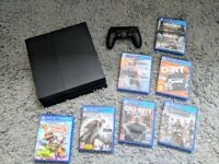 PS4 Console, 1 Controller, 7 Games and leads