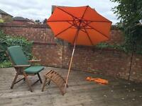 Garden chair, foot rest and parasol