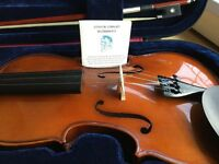 Full size violin for sale, good as new, bow and case included.
