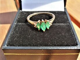 Emerald Ring. Three stone, 9 carat sized approx L