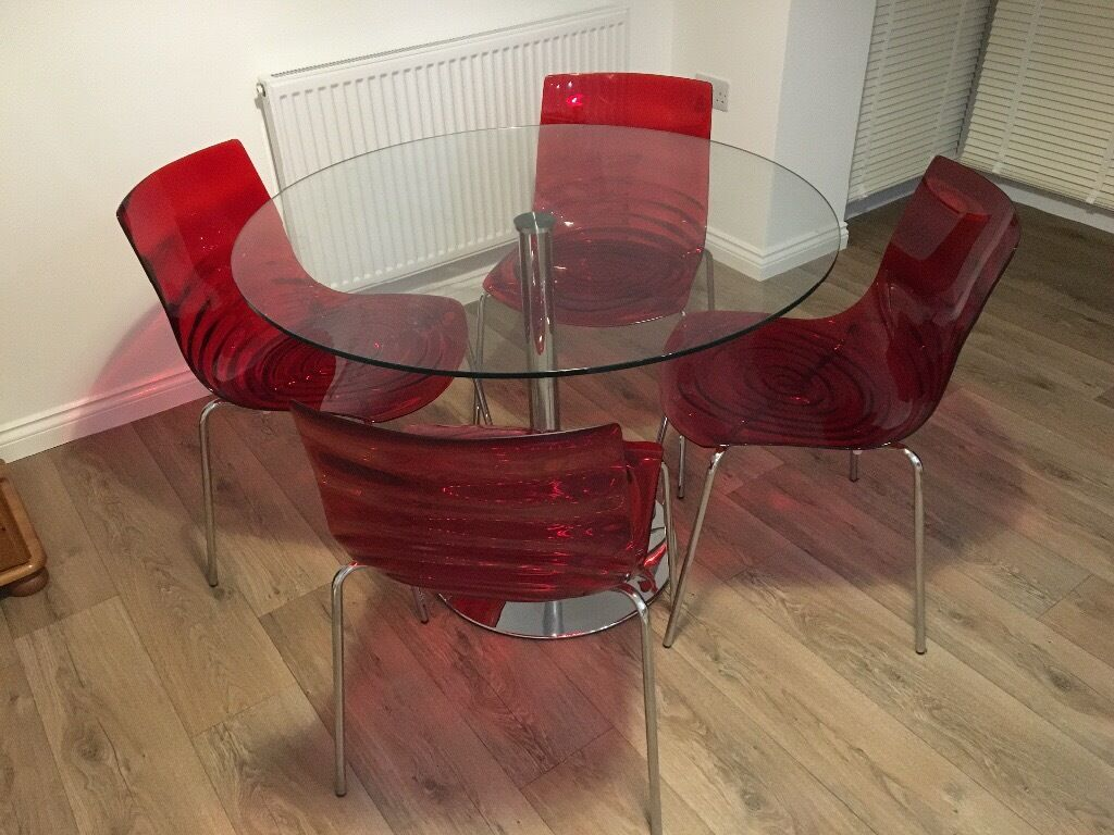 Contemporary Glass Italian Dining Table4 Chairsin Crofton, West YorkshireGumtree - Italian contemporary dining table & 4 chairs, featuring a unmarked glass top, single chromed leg/base with 4 red chairs for sale in the Crofton area of Wakefield. A great fit for any kitchen/diner with ample space for 4 place settings and serving...