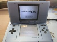 Nintendo DS console, charger and game