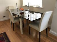 Italian black glass-top extendable table with leather-covered legs + 4 Italian chairs