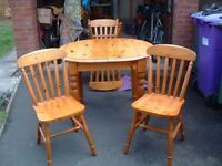 Pine extending dining table and four chairs, small marks on top, otherwise good condition