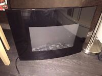 Electric fire for sale comes with wall bracket and remote...