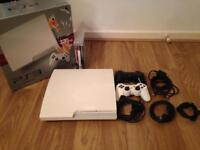 320GB PlayStation 3 Console in White, 2 controllers, 3 games