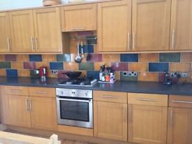 Veneer fitted kitchen with oven